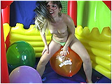 Video clip for sale of Debby bumpopping balloons inside a bouncy castle