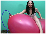 riding and bouncing on a big balloon while it inflates