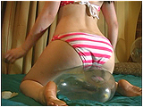 Video clip for sale of Victoria bum-popping clear balloons in her teeny bikini