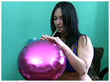 Kedra inflates and pops a pair of mylar balloons