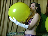 Video clip for sale of Eira inflating a balloon, in gloves