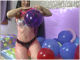 Video clip for sale of Debby stuffing tightly-inflated balloons into her fencenet body stocking