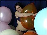 hugging balloons till they pop