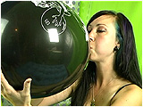 Video clip for sale of Eira inflating balloons before popping them