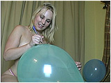 Video clip for sale of Miel using a pen to draw on balloons and to pop them