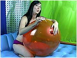 Video clip for sale of Eira poping balloons with toothpicks