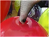 Video clip of Sophie foot-popping in fishnet stockings