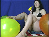 Wearing sheer nude stockings, Lea teases balloons with her feet