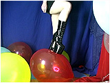 Adele foot-pops a bunch of balloons