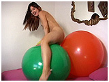 debby playing with 40 inch balloons