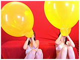 Video clip for sale of Alexxia and Atish racing to inflate a pair of 24-inch Qualatex balloons
