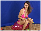Video clip for sale of Kitty inflating and popping lots of 17-inch balloons