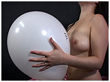 Alexxia inflates and plays with a clown-face balloon