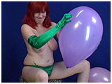 Video clip of Xev inflating some 14-inch balloons and then popping them while wearing gloves