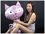 Kitty with a mylar balloon