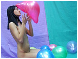 playing with a bunch of small balloons