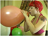 Video clip for sale of Victoria blowing to burst 12-inch balloons