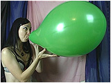 Video clip for sale of Eira blowing to pop a pair of 18-inch Everts balloons