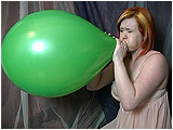 Video clip for sale of Xev blowing to pop a pair of 18-inch Everts balloons