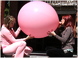 Video clip for sale of Holly and Raven sharing a 40-inch Tilco balloon outside