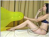 Video clip for sale of Eira trying to blow to pop a 24-inch Qualatex through a tube