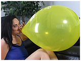 Kedra blows to burst a Balloon Directory Balloon