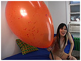 Video clip for sale of Debby blowing to pop two giant Chinese balloons