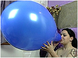 Video clip of Kat blowing to burst 16-inch balloons