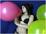 Brooke blows to pop two 16-inch Unique balloons