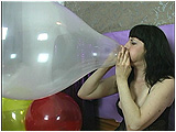 Video clip for sale of Heather blowing to pop a clear balloon
