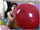 Video clip for sale of Brooke stuffing one balloon inside another and blowing
