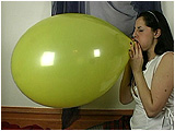 Video clip of Heather blowing to burst two balloons