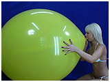Video clip for sale of Scarlette blowing to burst a 40-inch balloon