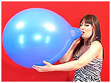Video clip for sale of Debbie blowing to pop a 16-inch balloon