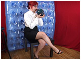 Video clip of Mistress Xev blowing to burst a pretty crystal balloon