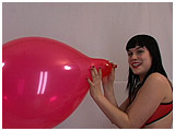 Video clip for sale of Lydiah blowing to burst a red balloon