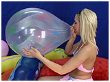 Video clip for sale of Scarlette blowing to burst a 16-inch clear Qualatex spray by mouth
