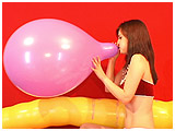 Video clip for sale of Atish blowing to burst a 16-inch Unique