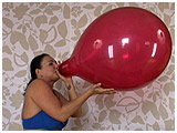 Video clip for sale of Kedra blowing to burst a 16-inch balloon