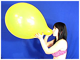 Video clip for sale of Lydiah blowing to burst a 16-inch balloon