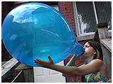 outdoor balloon blow to pop