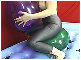 Video clip of Lizzie bum-popping balloons