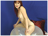 Debby rides a big clear balloon
