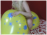 Video clip of Starla riding a big soft balloon with her hand between her legs