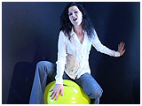 Video clip for sale of Mina bouncing on a balloon in tight jeans