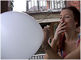Video clip for sale of Holly enjoying a Marlboro Lite and balloon on the porch