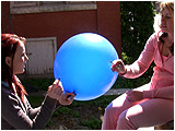 Video clip for sale of Holly and Raven smoking outside while sharing a balloon