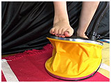 Video clip for sale of Atish pumping balloons with her feet