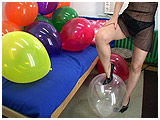 Video clip of Debby foot-popping balloons