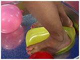 Video clip of Kitty stomping balloons in a metal wash tub